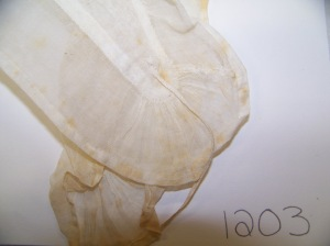 Close up of the end of the lappet of DAR 1203, showing gather of ruffle and string ties.