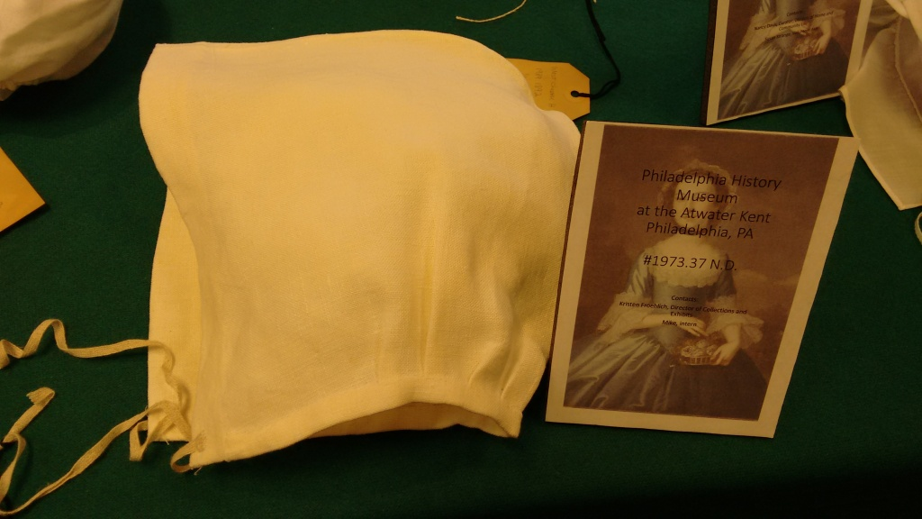 Saines' reproduction of simple 2-piece linen cap with linen tapes under the chin.