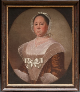 portrait of Mrs. Trusler in brown dress with large bow, and simple lappet.