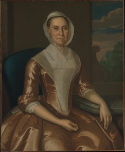18th c portrait of woman in plain brown gown with lappet cap.