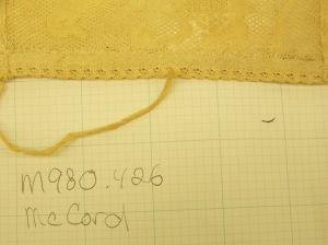 Cap McCord Museum #M980.4.26 photo by author.. Close up inside of bottom edge of lace headpiece.