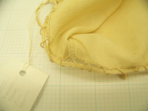 Cap McCord Museum #M980.4.26 photo by author. Close up of midpoint back, inside, of caul, showing construction of drawstring.