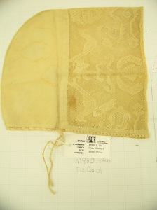 Cap McCord Museum #M980.4.26 photo by author. A rectangular headpiece of lace marks this cap as early (or late?) 18th C.